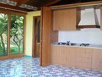 Casa sorrento kitchen side well equipped apartment with garden, gazebo sofa, car parking and pool