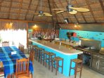 The palapa kitchen and dinning area for up to 20 is the perfect location for Chef prepared meals