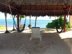Our grand beach palapa is the perfect spot to relax and take a short siesta