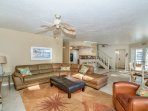 Great room with extra large sectional Leather sofa and leather club chair