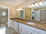 Master Bathroom with Two vanities and sinks - view into the room with shower.