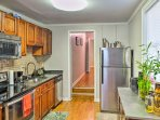 Relish the stainless steal appliances and granite counters.