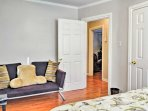 This last bedroom boasts a quaint sitting area.
