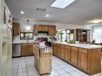 The fully equipped kitchen features stainless steel appliances and everything you'll need to prepare delectable meals.