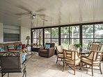Spread out and relax with your morning coffee in the welcoming sunroom looking out to the backyard filled with fruit...