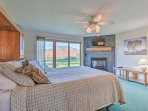 The master suite boasts a gas fireplace, a new Smart TV, and private porch with mountain vistas!