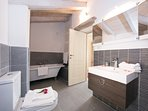 Bathroom with bathtub and separate shower