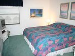 Spacious master bedroom with king size bed, TV, VCR and private bath.
