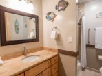 Upgraded bathroom with granite counter tops, tile flooring and half bath/shower combination.