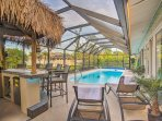 Step out onto the lanai to relax by the pool.