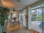 Sliding glass doors lead from the sunroom to the lanai.
