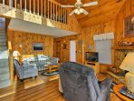 The spacious home features wood decor for that true cabin feel.