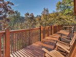 Enjoy peaceful Smoky Mountain views from the expansive deck.