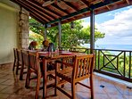Hand-crafted dining table for 10 on the verandah with spectacular views of the bay
