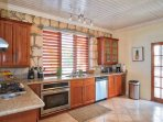 Kitchen with high quality appliances and view of the bay and pool deck