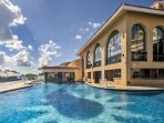 Enjoy happy hour right from the resort pool's swim-up bar!