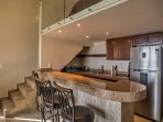 Sip your morning coffee or tea at the cozy breakfast bar, or out on the private balcony!
