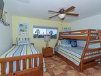 2nd Bedroom with Full plus two twin-size beds, HDTV, large window overlooking bay and boat docks
