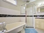 Enjoy a master bathroom with a clawfoot tub and stand-up shower.