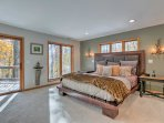 Wake up naturally to the morning light while cuddled in this queen bed.