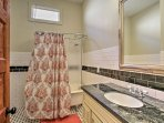 The second shared bathroom is  great for additional space to get ready and has a clawfoot tub and stand-up shower.
