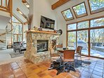 Natural light streams into the open living space with high vaulted ceilings.