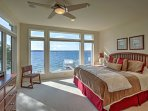 Wake up to endless lake views in the master bedroom.