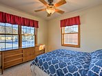 A third bedroom features a queen bed, ceiling fan, and storage for your belongings.