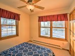 Sleep soundly in the second bedroom furnished with a queen bed.