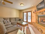 Prop up your feet in front of the gas fireplace while watching shows on the flat-screen cable TV.