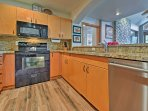 The kitchen features stainless steel appliances and granite countertops!