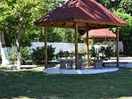 Gazebo set in fruited landscaped with spa retreat in the background beautiful views all around.