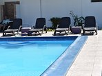 Quality cruse ship swimming pool side loungers plus tables for the ultimate relaxation settings