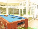 Large conservatory with pool table
