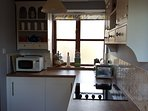 Fully equipped country kitchen with fridge, washing machine and dishwasher