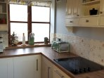 Fully equipped country kitchen with original Suffolk brick floor