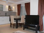 Well equipped kitchen and flat screen TV