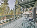 Situated in a wooded Running Springs neighborhood, this cabin boasts views of the San Bernardino National Forest.