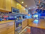 The kitchen is fully equipped with stainless steel appliances and an island.