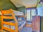 Kids will love sharing the twin-over-full bunk bed in this bedroom!