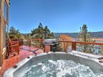 The hot tub sits on the elevated back deck for amazing views of the lake and snow
