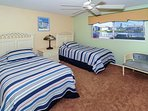 2nd Bedroom with two twin-size beds, HDTV, large window overlooking bay and boat docks