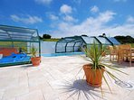 Shared indoor/outdoor heated swimming pool