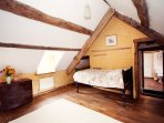 Single bed in the king-size bedroom