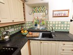 The well equipped cottage style kitchen