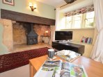 Lounge with exposed beams and inglenook fireplace