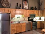 Brand New Appliances In Fully Stocked Kitchen