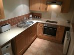 Kitchen recently redone,to incorporate a normal sized oven,much better now.
