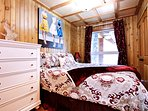The Second Upstairs Bedroom with a Queen Size Bed and Closet