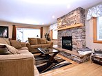 In the 'Great Room' Cozy up on the comfy sofas to a Rustic Rock Feature Gas Fireplace and TV